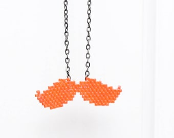 Hand woven orange mustache necklace