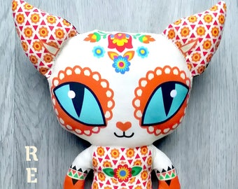 """FLOR-FUEGO"" the Fiery cat doll / toy made of 100% organic cotton fabric, shown both sides, flower, Mexico"