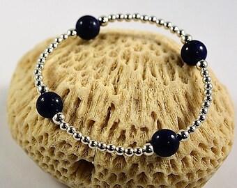 BR QUATRO PERLAS Silver pearl bracelet with four lapis lazuli pearls