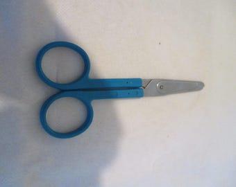 pair of round blue scissors