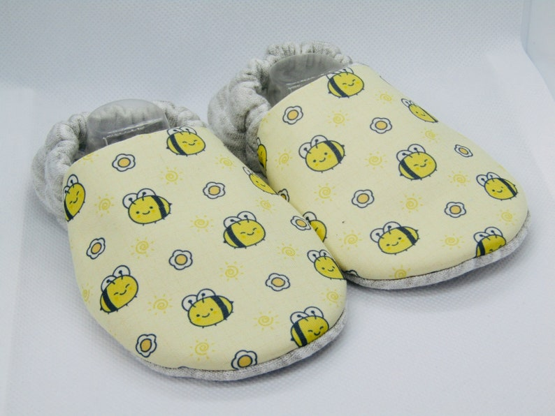 Bee patterned handmade baby booties available in sizes up to image 0