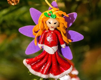 Girl in red and white hanging - Christmas decoration / Christmas tree