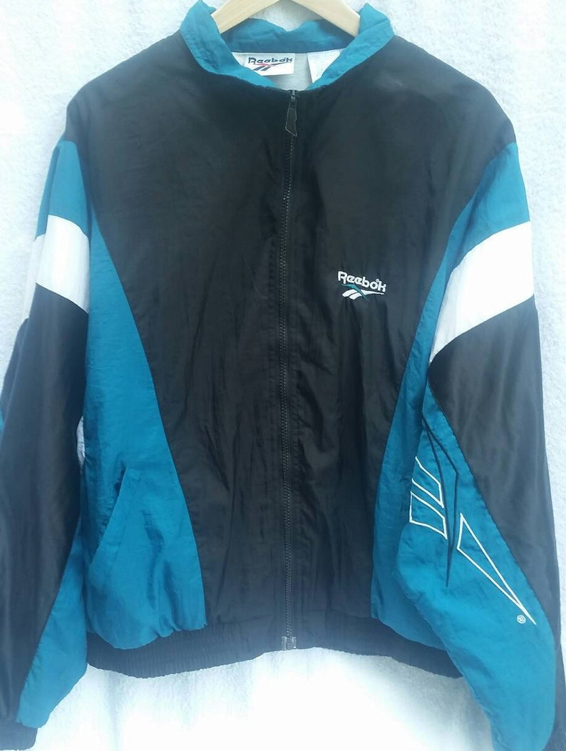 a2fb6bb574cea Retro Reebok Windbreaker Color Block Aqua Black White 80s Track Jacket  Retro Sport Coat Lined Windbreaker. Made in Taiwan.