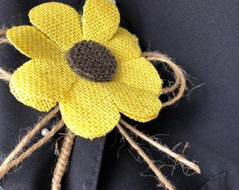 Hessian sunflower buttonholes. Rustic sunflower buttonhole. Wedding flower idea.