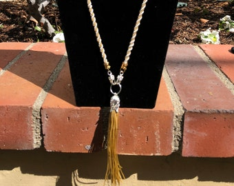 26.5 inch Gold Silk Kumihimo Braid Necklace with a 5 inch Tassel Embellished with 4 Strands of Pearls and Crystal Charms