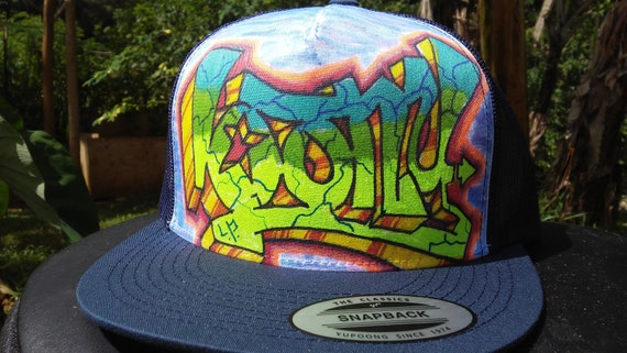 ca8d4d374bb77 Loony graffiti trucker hat Have some loony in your life
