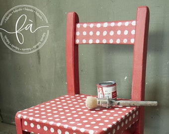 Small wooden chair for children painted and decorated by hand with chalk dyes.