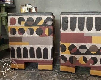 Pair of compactly shaped bedside tables decorated with material-effect plaster paints with African-style designs. Black glass shelf.