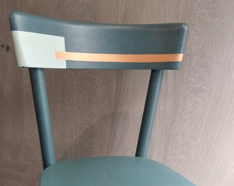 Old chair with a classic shape decorated with geometric patterns in sea blue, light blue and a touch of copper. Water-based paints