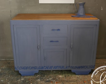 An old kitchen sideboard with three doors and two drawers. The plan was returned to the rough and treated with natural waxes.