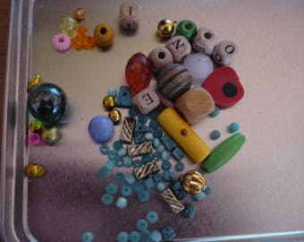Set of multicolored beads of different shapes