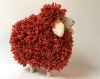 Wooden sheep and wool Red