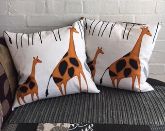 Duck feather cushion with giraffe cover