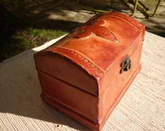 wooden box covered in embossed with fleur de lis embossed leather