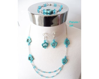Adornment in turquoise, blue adornment. Jewelry glass beads and flowers in Turquoise. Blue jewelry