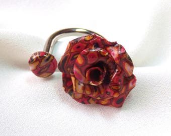 Flower ring * graphics * predominantly red and gold