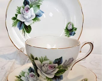 Royal Sutherland White Rose pattern trio - cup, saucer and side plate.