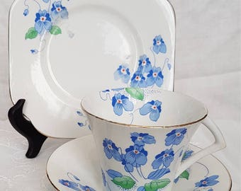 Colclough trio, cup, saucer and sideplate in blue flower pattern.