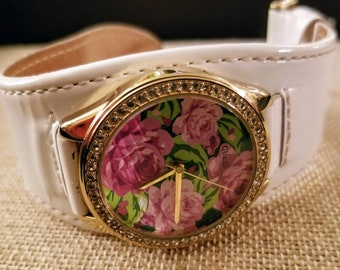 9f5c97fe7fd GUESS ladies Watch white leather band gold floral face surrounding stones