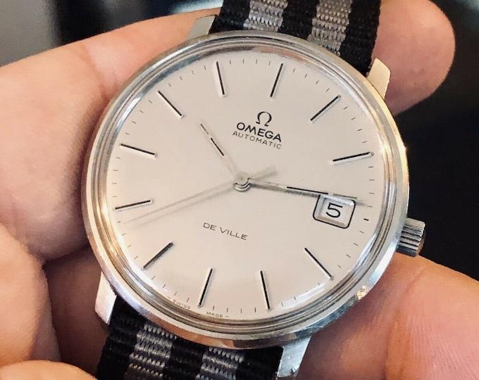 Omega Vintage 1970s Mens De Ville Automatic Nato James Bond Watch CAL 1002  Black Leather Stainless Steel Bracelet + New Box