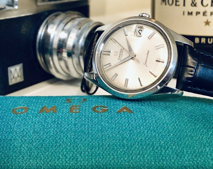 Omega Seamaster vintage watch Mechanical Automatic Cal 562 Stainless Steel with Date and black leather 1960s used second hand + Box