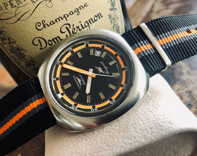 Longines Conquest Vintage rotating Bezel Divers Orange 1970s Black Dial watch with ery Rare watersports using in-house caliber 6651- 25J
