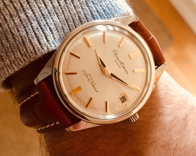 1968 Orient Olympia calendar 23 jewels date display mechanical stainless steel mens gents dress watch
