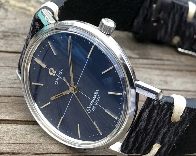 Omega Mens Seamaster De Ville Blue Crosshair Dial 1960s Mens vintage steel watch with new box and rustic navy strap