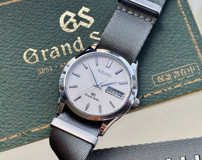 Grand Seiko Quartz men's Steel Bracelet Box Papers Japan 36.50mm vintage Day Date watch