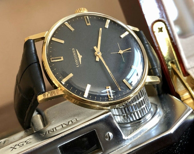 Longines Conquest used Mechanical 18K gold black dial sub seconds 1950s watch