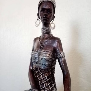 9 inches tall. African Carving Signed Baki Approx