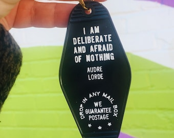 Deliberate and afraid of nothing throwback hotel keychain