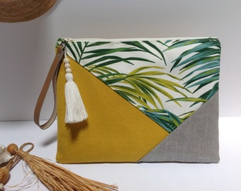 Cover print and yellow tropical with leather strap.