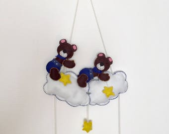 Two cute teddy bears on a cloud. Mobile.