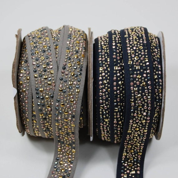 Ribbon elastic 25mm light grey studded gold and silver x1m