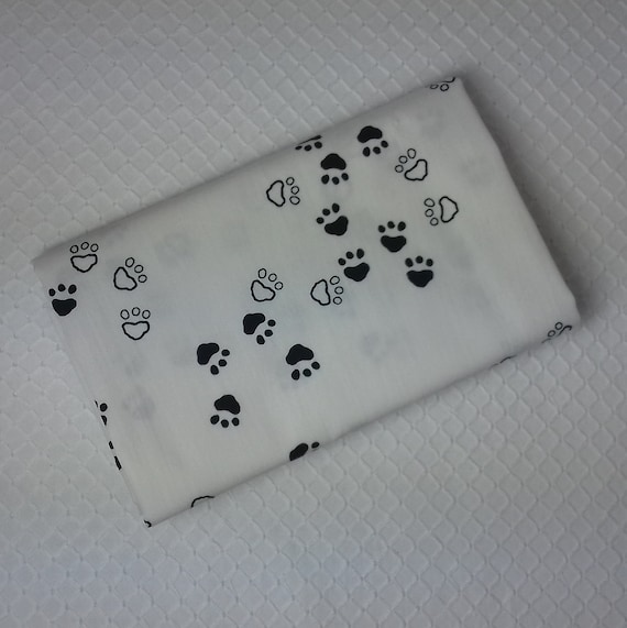 CAPSULES Coupon fabric is cotton patchwork bear graphic black and white x paw prints designs 50 cm