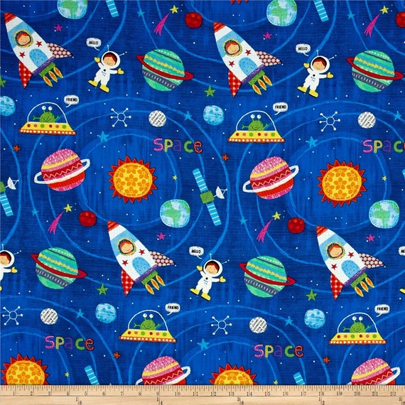 SPACE fabric cotton multicolored patchwork design of a child in space aliens evec on blue x50cm