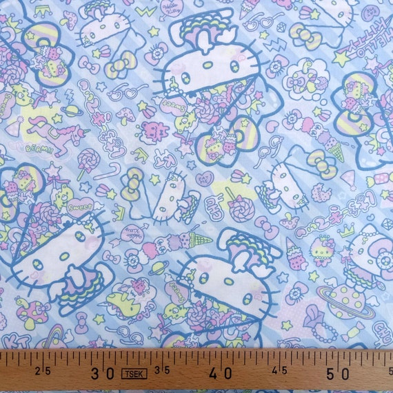 HELLO KITTY fabric cotton patchwork design cat the most famous of the world on blue x50cm