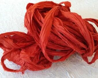 Sari Silk Ribbon Yarn. Silk ribbon. Fire red recycled sari Silk Ribbon. 100 g 50-70 m.