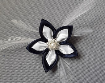 Satin blue and white brooch
