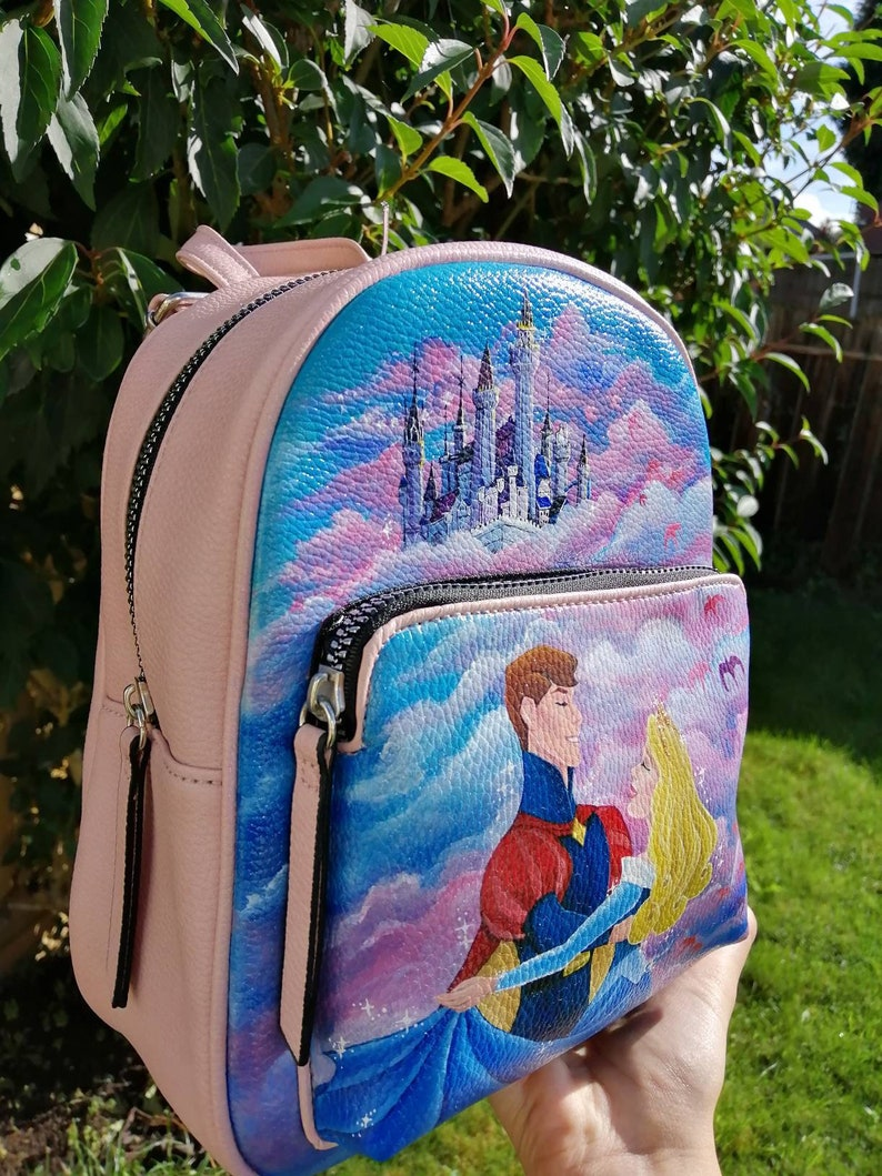 24 Unique Disney Gift Ideas featured by top US Disney blogger, Marcie and the Mouse Original Handpainted Disney Sleeping Beauty Backpack Aurora image 0