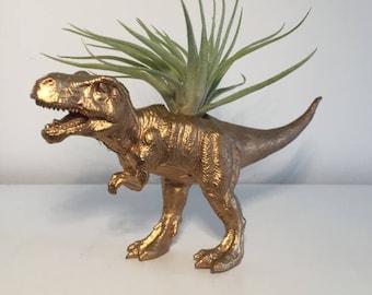 Gold Dinosaur Holding A Donut