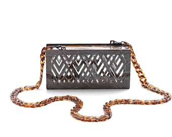 Asra acrylic clutch in brown marble