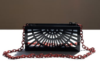 Phoebe acrylic clutch in black with mirror