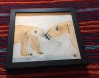 Two polar bears kissing.