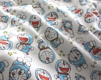 Doraemon print on gray jersy fabric