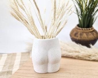 Speckled ceramic bum vase