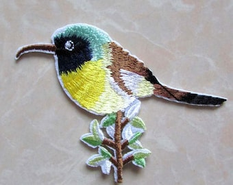 bird, hummingbird, in thermostick fabric, applies coat of arms to iron or sew