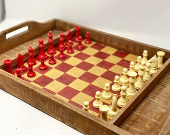 Old chess tray with pieces