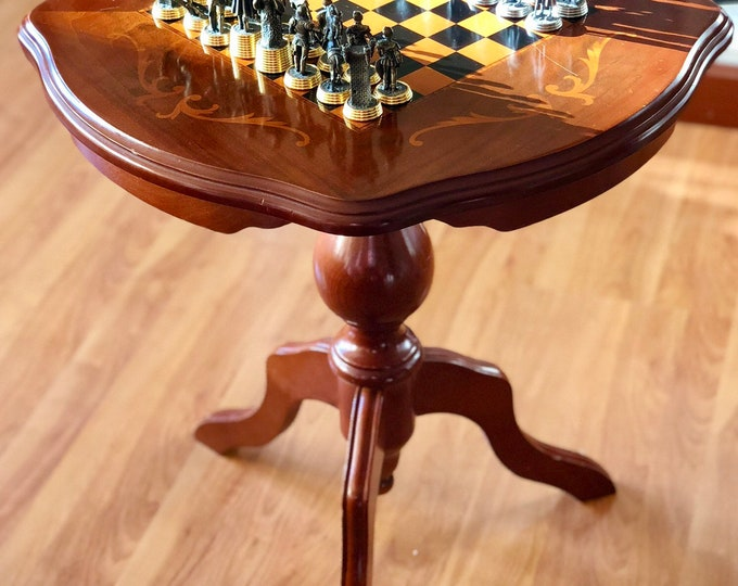 Chess table with tin pieces with gold and silver